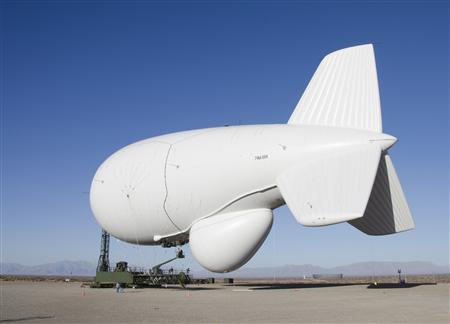 A Raytheon Joint Land Attack Cruise Missile Defense Elevated Netted Sensor System (JLENS) aerostat is pictured at the White Sands Missile Range, New Mexico, in this February 24, 2012 photo obtained on February 1, 2013. A pair of the bulbous, helium-filled 'aerostats' - each more than three quarters the length of a football field at 243 feet (74 meters) are to be added to a high-tech shield designed to protect the Washington DC area from air attack. Picture taken February 24, 2012. REUTERS/John Hamilton/DVIDS/Handout