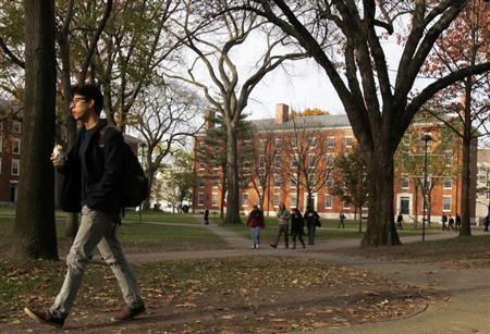 A man walks through Harvard Yard at Harvard University in Cambridge, Massachusetts November 16, 2012. REUTERS/Jessica Rinaldi/Files