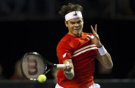 Canada's Milos Raonic hits a return to Spain's Albert Ramos during the first round of the Davis Cup tennis tie in Vancouver, British Columbia February 1, 2013. REUTERS/Ben Nelms