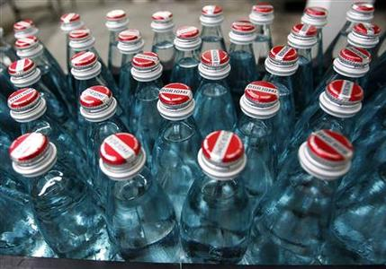 Bottled mineral water from Borjomi are seen at the production line of the IDS Borjomi Georgia's factory in the town of Borjomi, some 150 km (93 miles) southwest of Tbilisi, January 30, 2013. REUTERS/David Mdzinarishvili