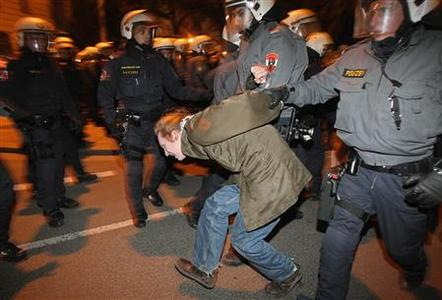 Police arrest a protester during a demonstration against an Austrian Freedom Party (FPOe) ball in Vienna February 1, 2013. REUTERS/Heinz-Peter Bader