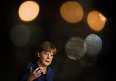German Chancellor Angela Merkel speaks at a ceremonial act of the BDI German industry association in Berlin January 29, 2013. German industry is worried about a currency devalution race following recent decisions by the Bank of Japan to ease policy, BDI industry federation chief Ulrich Grillo said on Tuesday. REUTERS/Thomas Peter (GERMANY - Tags: POLITICS BUSINESS)