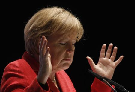 German Chancellor Angela Merkel gestures during a election campaign in the western town of Soest April 26, 2010. REUTERS/Ina Fassbender