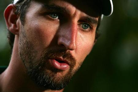 Australian test cricketer Jason Gillespie talks during a television interview at a resort in Coolum, about 110 km (68 miles) north of Brisbane, August 29, 2006. REUTERS/Tim Wimborne/Files