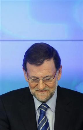 Spanish Prime Minister and the ruling People's Party (PP) leader Mariano Rajoy presides over his party's national executive committee in Madrid February 2, 2013. The People's Party denied on Thursday that Rajoy and other leaders received payments from a slush fund after a newspaper published what it said were secret party accounts. El Pais published images of excerpts of almost two decades of handwritten accounts that it said were maintained by People's Party treasurers. The newspaper said the accounts showed 11 years of payments to Rajoy of 25,200 euros ($34,200) a year. REUTERS/Susana Vera (SPAIN - Tags: CRIME LAW POLITICS BUSINESS)