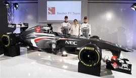 Sauber Formula One team principal Monisha Kaltenborn (C) poses with F1 drivers Nico Hulkenberg (L) of Germany and Esteban Gutierrez of Mexico after unveiling the C32-Ferrari car at the company's headquarters in Hinwil, east of Zurich February 2, 2013. REUTERS/Michael Buholzer