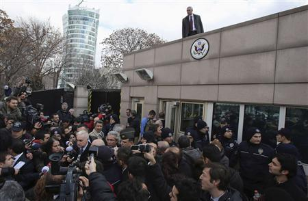 U.S. Ambassador to Turkey Francis Ricciardone (L, with white hair) speaks to media outside of the U.S. Embassy in Ankara February 1, 2013. A suicide bomber from a far-left group killed a Turkish security guard at the U.S. embassy in Ankara on Friday, blowing the door off a side entrance and sending smoke and debris flying into the street. The attacker blew himself up inside U.S. property, Ankara Governor Alaaddin Yuksel said. The blast sent masonry spewing out of the wall and could be heard a mile away. REUTERS/Stringer
