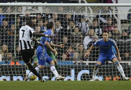 Newcastle United's Moussa Sissoko (L) shoots to score against Chelsea during their English Premier League soccer match in Newcastle, northern England February 2, 2013. Seen on right is Chelsea's John Terry. REUTERS/Nigel Roddis