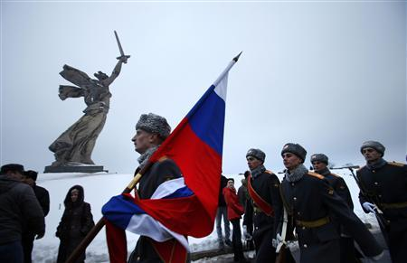 Russian soldiers march at the Mamayev Kurgan (Mamayev Hill) World War Two memorial complex, with the statue of Mother Homeland in the background during celebrations in the city of Volgograd February 2, 2013. REUTERS/Alexander Zemlianichenko/Pool