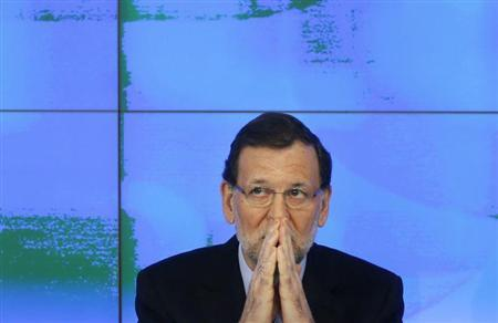 Spanish Prime Minister and the ruling People's Party (PP) leader Mariano Rajoy gestures as he presides over his party's national executive committee in Madrid February 2, 2013. REUTERS/Susana Vera