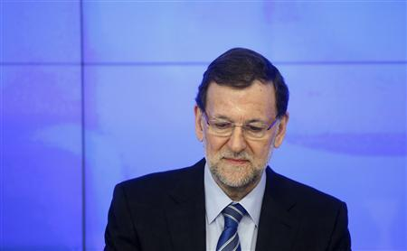 Spanish Prime Minister and the ruling People's Party (PP) leader Mariano Rajoy presides over his party's national executive committee in Madrid February 2, 2013. The People's Party denied on Thursday that Rajoy and other leaders received payments from a slush fund after a newspaper published what it said were secret party accounts. El Pais published images of excerpts of almost two decades of handwritten accounts that it said were maintained by People's Party treasurers. The newspaper said the accounts showed 11 years of payments to Rajoy of 25,200 euros ($34,200) a year. REUTERS/Susana Vera