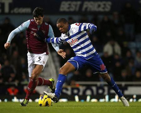 West Ham United's James Tomkins (L) challenges Queens Park Rangers Loic Remy during their English Premier League soccer match at Upton Park in London January 19, 2013. REUTERS/Eddie Keogh