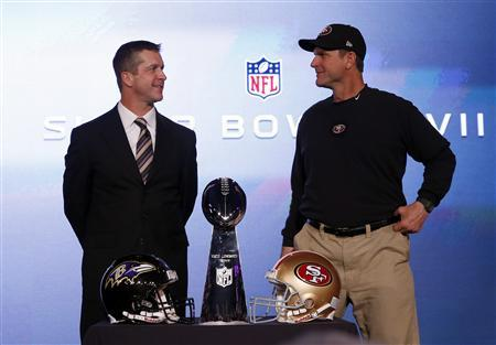 San Francisco 49ers head coach Jim Harbaugh (R) and his brother, Baltimore Ravens head coach John Harbaugh, appear at their joint press conference and stand next to the Vince Lombardi trophy ahead of the NFL's Super Bowl XLVII in New Orleans, Louisiana, February 1, 2013. The San Francisco 49ers will meet the Baltimore Ravens for the NFL championship February 3. REUTERS/Jim Young