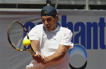 Spanish tennis player Rafael Nadal hits a return during a training session at country club Las Salinas in Vina del Mar city, about 121 km (75 miles) northwest of Santiago February 2, 2013. REUTERS/Eliseo Fernandez