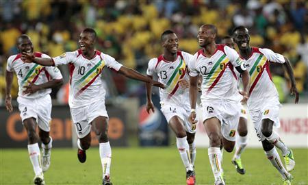 Mali's captain Seydou Keita (12) celebrates with his teammates following their victory over South Africa during their African Cup of Nations (AFCON 2013) quarter-final soccer match at the Moses Mabhida stadium in Durban, February 2, 2013. REUTERS/Rogan Ward