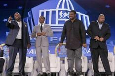 Tampa Bay Buccaneers player Warren Sapp (L), former Minnesota Vikings player Cris Carter (2nd L), former Baltimore Ravens player Jonathan Ogden (2nd R) and former Dallas Cowboys player Larry Allen (R) stand together after being named to the Pro Football Hall of Fame at the 2013 Class of Enshrinement show in New Orleans, Louisiana, February 2, 2013. REUTERS/Jim Young (UNITED STATES - Tags: SPORT FOOTBALL)