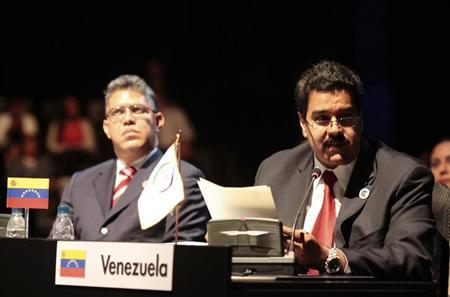 Venezuela's Vice President Nicolas Maduro (R) reads a letter from President Hugo Chavez as he is accompanied by his Foreign Minister Elias Jaua as they attend at a general meeting at the summit of the Community of Latin American and Caribbean States (CELAC) in Santiago, January 28, 2013. DATE IMPORTED: January 28, 2013 Venezuela's Vice President Nicolas Maduro (R) reads a letter from President Hugo Chavez as he is accompanied by his Foreign Minister Elias Jaua as they attend at a general meeting at the summit of the Community of Latin American and Caribbean States (CELAC) in Santiago, January 28, 2013. REUTERS/Miraflores Palace/Handout