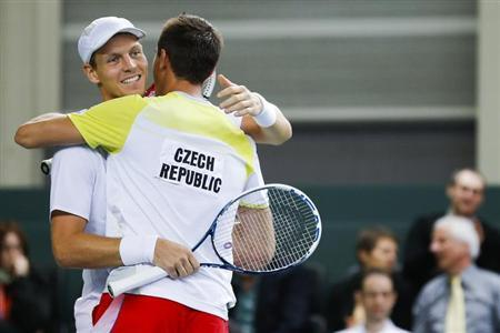 Tomas Berdych (L) of the Czech Republic celebrates with his team mate Lukas Rosol after winning his Davis Cup world group round 1 tennis doubles match against Stanislas Wawrinka and Marco Chiudinelli of Switzerland at Palexpo in Geneva February 2, 2013. REUTERS/Valentin Flauraud
