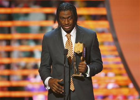 Washington Redskins quarterback Robert Griffin III accepts the the award for the NFL Offensive Rookie of the year during the NFL Honors award show in New Orleans, Louisiana February 2, 2013. REUTERS/Jeff Haynes