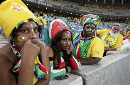 South African soccer fans look on after their team lost to Mali during their African Cup of Nations (AFCON 2013) quarter-final soccer match at the Moses Mabhida stadium in Durban, February 2, 2013. REUTERS/Rogan Ward