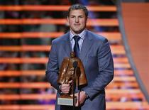 Dallas Cowboys Jason Witten holds the Walter Payton Man of the Year Award after it was presented to him during the NFL Honors award show in New Orleans, Louisiana February 2, 2013. REUTERS/Jeff Haynes