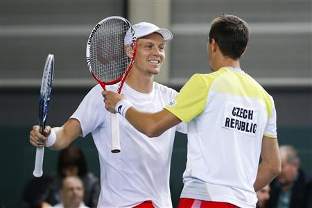 Tomas Berdych (L) of the Czech Republic celebrates with his team mate Lukas Rosol after winning his Davis Cup world group round 1 tennis doubles match against Stanislas Wawrinka and Marco Chiudinelli of Switzerland at Palexpo in Geneva February 2, 2013. With a duration of seven hours and one minute, the match was the longest in Davis Cup history. REUTERS/Valentin Flauraud