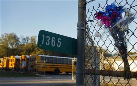 Flowers in honor of murdered school bus driver Charles Poland are attached to a fence at the entrance to the Dale County Bus Barn on Highway 27 outside Ozark, Alabama, near Midland City, February 1, 2013. . REUTERS/Phil Sears