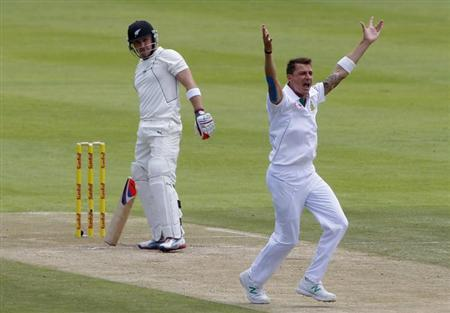South Africa's Dale Steyn (front) appeals unsuccessfully for the wicket of New Zealand's Bredon McCullum on the second day of their first cricket Test match in Cape Town, January 3, 2013. REUTERS/Mike Hutchings