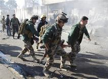 Au moins 33 personnes sont mortes dans l'attaque à la voiture piégée d'un commissariat de police dimanche matin à Kirkouk, dans le nord de l'Irak. L'explosion a fait également quelque 70 blessés et des corps restent ensevelis sous les débris des parties de bâtiments effondrées. /Photo prise le 3 février 2013/REUTERS/Ako Rasheed