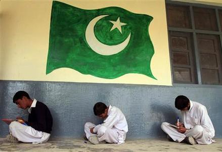 Students sit near an image of Pakistan's national flag during class at the Musa Neka Public School in Wana, the main town in Pakistan's South Waziristan tribal region bordering Afghanistan November 28, 2012. In a Pakistan army base high in the mountains on the Afghan frontier, a general explains a strategy for fighting the Taliban he calls simply ''WHAM'' - winning hearts and minds. According to the army narrative, the campaign includes winning over the region's ethnic Pashtun tribes through dialogue, creating commercial opportunities and providing education in new schools and colleges. REUTERS/Faisal Mahmood