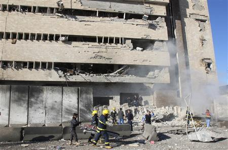 Iraqi security personnel are seen at the site of a suicide bomb attack in Kirkuk, 250 km (155 miles) north of Baghdad February 3, 2013. A suicide bomber driving a car and gunmen disguised in police uniforms killed at least 33 people in the Iraqi city Kirkuk on Sunday when they tried to storm the police headquarters. REUTERS/Ako Rasheed