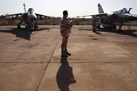 A French soldier stands between two Mirage F1 fighter jets at the Malian army air base in Bamako January 14, 2013. REUTERS/Joe Penney