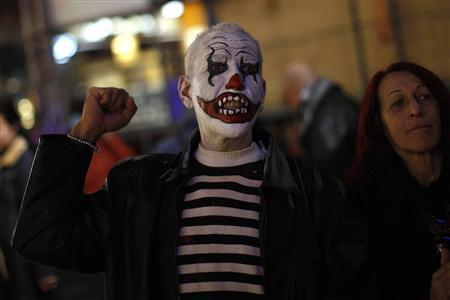 A demonstrator who is dressed up for the carnival shouts slogans during a protest against political corruption at La Constitucion Square in Malaga, southern Spain, February 2, 2013. Spanish Prime Minister Mariano Rajoy on Saturday denied wrongdoing in a growing corruption scandal that threatens his credibility just as he makes headway against the economic crisis. REUTERS/Jon Nazca