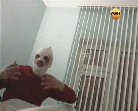 Sergei Filin, artistic director of Russia's prestigious Bolshoi Ballet, gestures during an interview in a still image from footage shot by REN TV in a Moscow hospital January 18, 2013. REUTERS/REN TV via Reuters TV