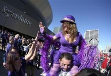 Baltimore Ravens fans cheer in front of the Superdome before the NFL Super Bowl XLVII football game against the San Francisco 49ers in New Orleans, Louisiana, February 3, 2013. REUTERS/Sean Gardner (UNITED STATES - Tags: SPORT FOOTBALL)