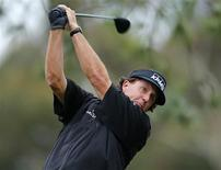U.S. golfer Phil Mickelson hits off the 11th tee of the north course at Torrey Pines during first round play at the Farmers Insurance Open in San Diego, California January 24, 2013. REUTERS/Mike Blake