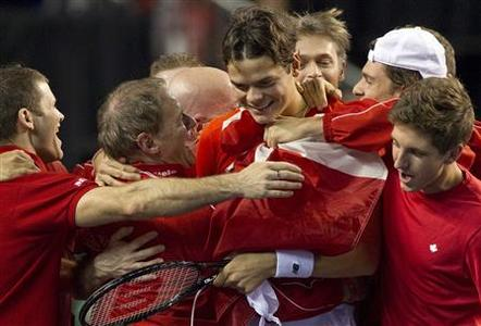 Canada's Milos Raonic celebrates his win over Spain's Guillermo Garcia-Lopez with teammates during the final round of the Davis Cup tennis tie in Vancouver, British Columbia February 3, 2013. REUTERS/Ben Nelms