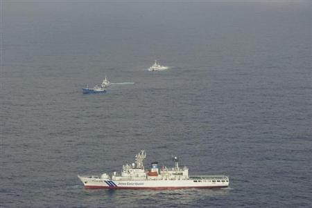 A Chinese fishing boat (C, blue) and Japan Coast Guard vessels are seen in waters east-northeast of Miyako Island, Okinawa prefecture, in this handout released by 11th Regional Coast Guard Headquarters-Japan Coast Guard February 2, 2013. REUTERS/11th Regional Coast Guard Headquarters-Japan Coast Guard/Handout