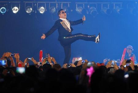 South Korean rapper Psy performs during a concert in Bangkok November 28, 2012. REUTERS/Chaiwat Subprasom