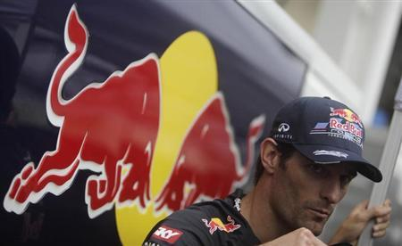 Red Bull Formula One driver Mark Webber of Australia is interviewed after the qualifying session of the Brazilian F1 Grand Prix at Interlagos circuit in Sao Paulo November 24, 2012. REUTERS/Ricardo Moraes/Files