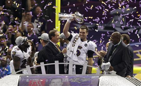 Baltimore Ravens quarterback Joe Flacco (C) raises the Vince Lombardi Trophy as he celebrates victory over the San Francisco 49ers in their NFL Super Bowl XLVII football game in New Orleans, Louisiana, February 3, 2013. REUTERS/Jim Young