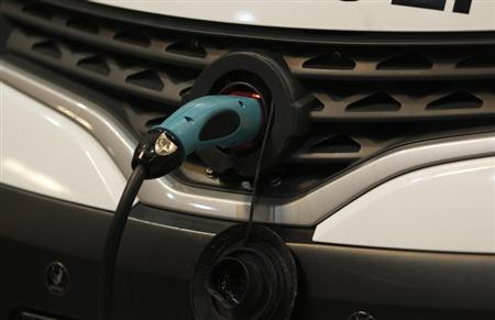 An electric car is charged at a battery charging station at the 'International CAR Symposium' in Bochum January 29, 2013. REUTERS/Ina Fassbender