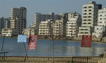 A view of the ghost town of Famagusta is seen in northern Cyprus, May 2, 2003. Cyprus has been ethnically separated since Turkey invaded on July 20, 1974, and seized the northern third of territory, five days after a Greek Cypriot coup aimed at union with Greece. REUTERS/Andreas Manolis