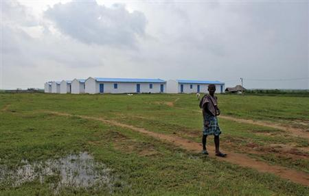 A villager walks past closed POSCO India transit camp at Balitutha in Jagatsingpur district in Odisha October 12, 2012. REUTERS/Stringer