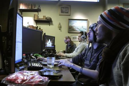 Coders work in the Mojang company office in Stockholm January 21, 2013. REUTERS/Ints Kalnins