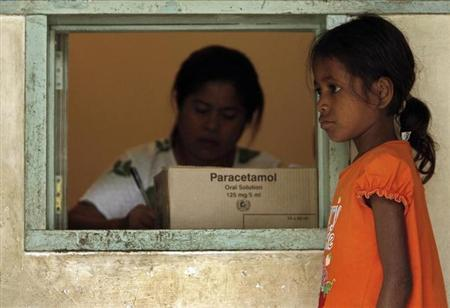 A child waits to receive immunisation against tuberculosis with the vaccine, BCG, in Dili May 7, 2007. REUTERS/Beawiharta/Files