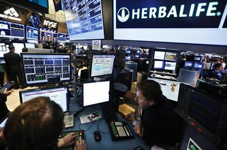 Traders work at the post that trades Herbalife stock on the floor of the New York Stock Exchange, January 10, 2013. REUTERS/Brendan McDermid