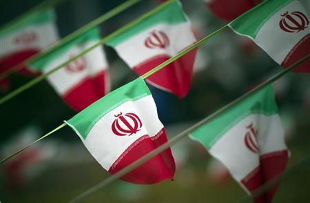 EDITORS' NOTE: Reuters and other foreign media are subject to Iranian restrictions on leaving the office to report, film or take pictures in Tehran. Iran's national flags are seen on a square in Tehran February 10, 2012. REUTERS/Morteza Nikoubazl