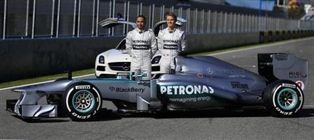 British F1 racing driver Lewis Hamilton (L) and Nico Rosberg of Germany pose during the presentation of the new Mercedes W04 Formula One car at the Jerez racetrack in southern Spain February 4, 2013. REUTERS/Marcelo del Pozo