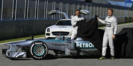 Mercedes Formula One racing driver Lewis Hamilton (L) of Britain and teammate Nico Rosberg of Germany unveil the new Mercedes W04 Formula One car during its presentation at the Jerez racetrack in southern Spain February 4, 2013. REUTERS/Marcelo del Pozo
